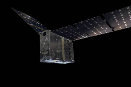 Illustration looks like a square, refigerator-shaped spacecraft with large solar panels resembling wings