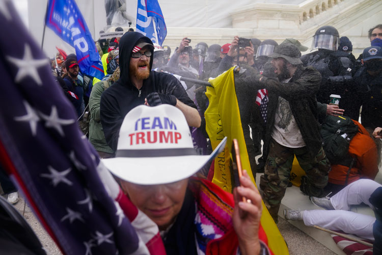 Trump supporters trying to break through police barrier at U.S. Capitol on Jan. 6