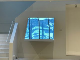 """Photo of """"Lateral Sky View""""--an artistic installation allowing a view of the sky through a mirror"""