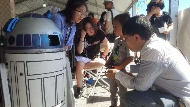 A child examines a robot