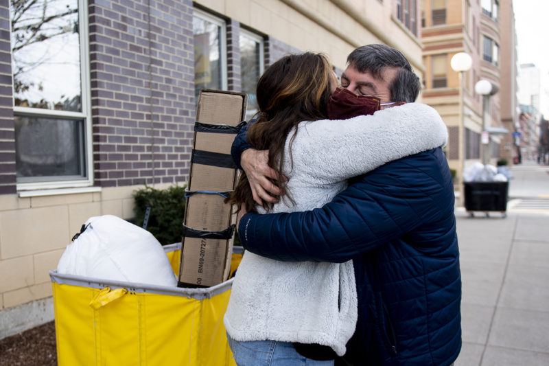 Jacki Smith, a first-year Northeastern student, hugs her father Gary Smith goodbye after moving into her dormitory on Columbus Avenue. Photo by Ruby Wallau/Northeastern University
