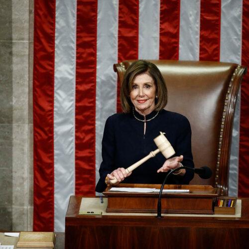 House Speaker Nancy Pelosi holds the gavel.